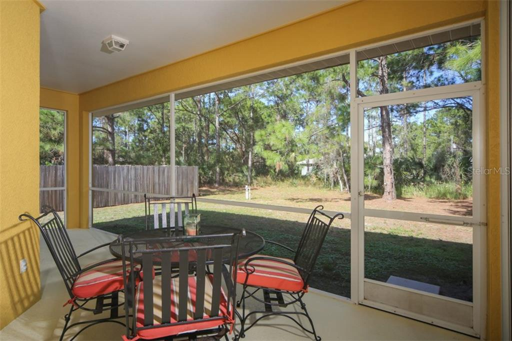 Covered lanai - Single Family Home for sale at 1876 Bushnell Ave, North Port, FL 34286 - MLS Number is A4207073