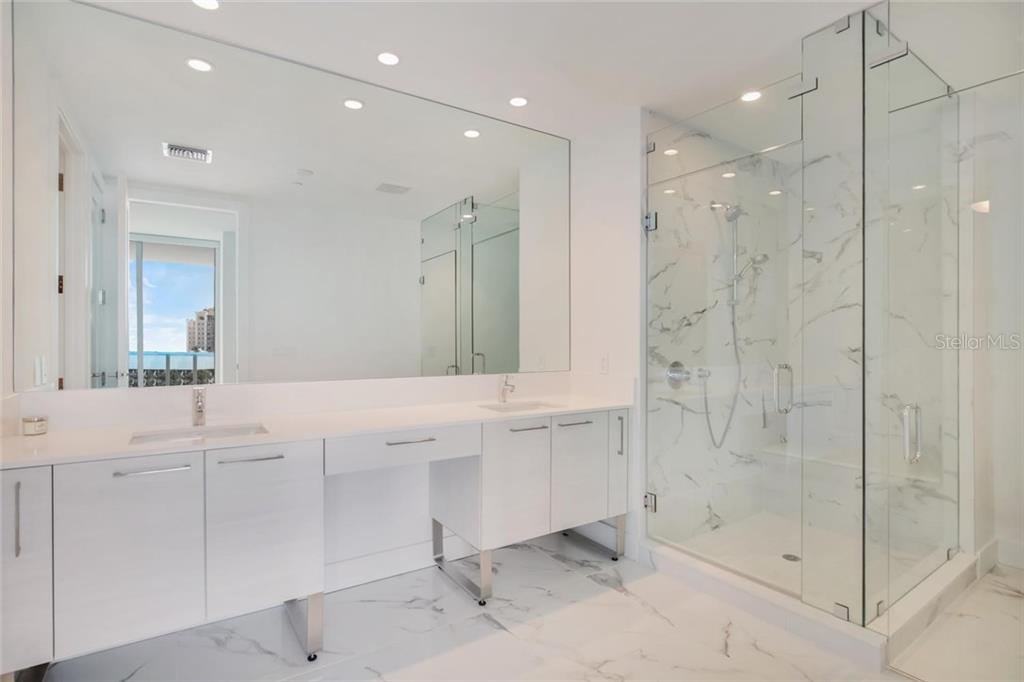 Master bath room with double sink vanity - Condo for sale at 1155 N Gulfstream Ave #304, Sarasota, FL 34236 - MLS Number is A4208934