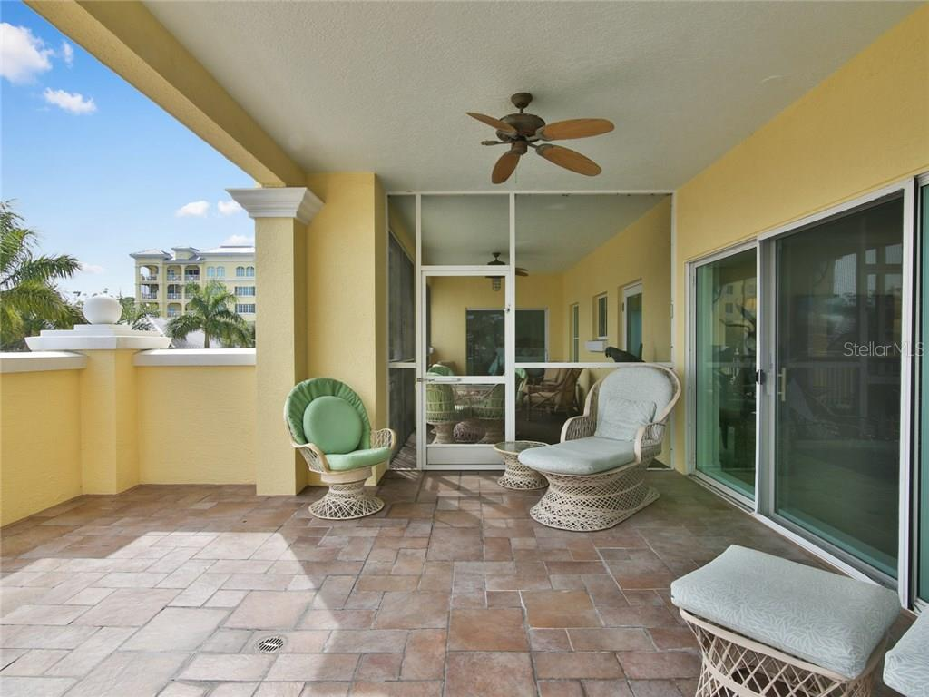 Large open air and screened terrace off living room and master bedroom - Condo for sale at 1310 Old Stickney Point Rd #e21, Sarasota, FL 34242 - MLS Number is A4209502