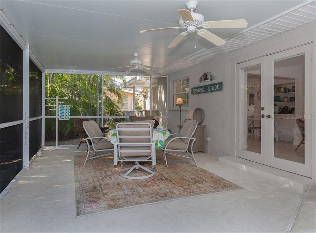 Lanai with doors to dining area - Single Family Home for sale at 445 Mahon Dr, Venice, FL 34285 - MLS Number is A4209507