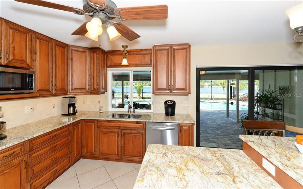 Kitchen with easy access to the screened lanai. - Single Family Home for sale at 5122 Willow Leaf Dr, Sarasota, FL 34241 - MLS Number is A4209555