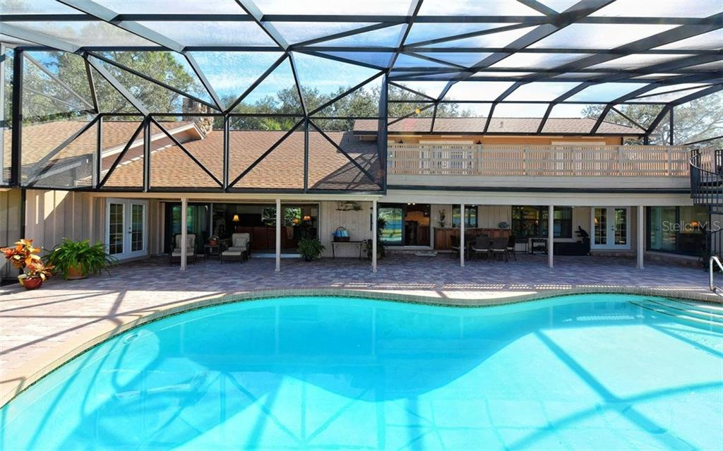Outdoor oasis with sun deck above, covered living space, large pool and spacious paver lanai. - Single Family Home for sale at 5122 Willow Leaf Dr, Sarasota, FL 34241 - MLS Number is A4209555