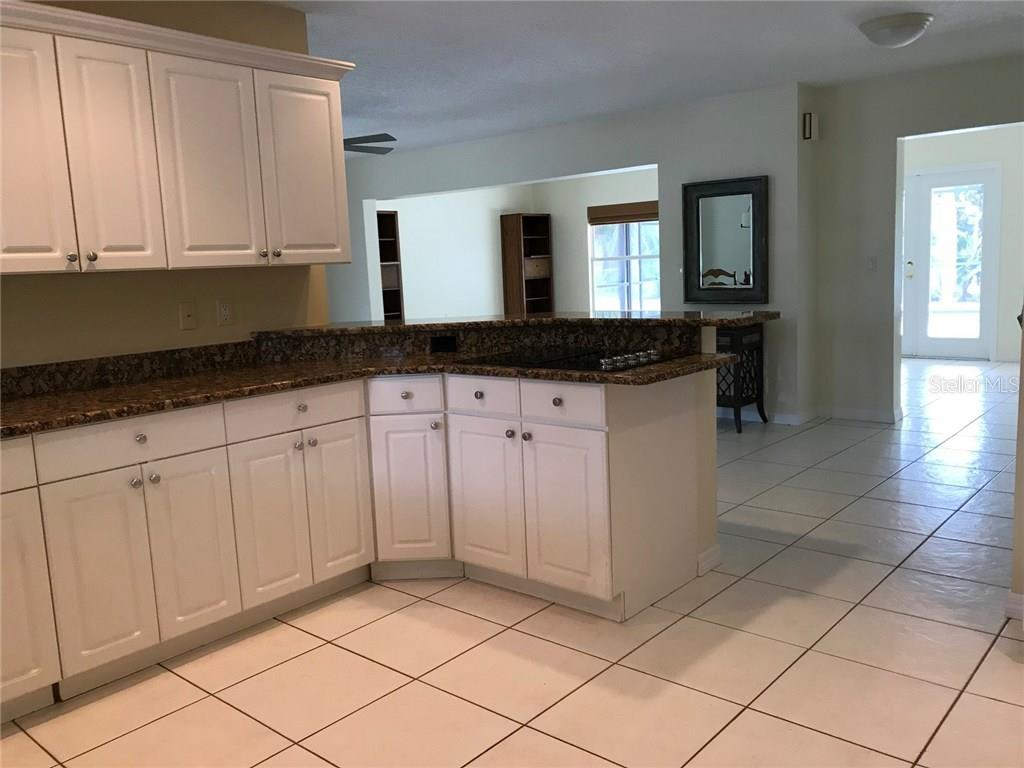 Kitchen view into Great room - Single Family Home for sale at 5530 Cape Leyte Dr, Sarasota, FL 34242 - MLS Number is A4209986