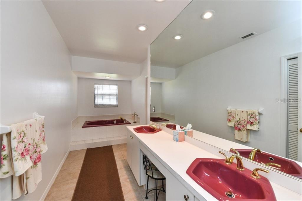Master Bath with dual sinks, jetted tub.  Walk in shower is rear left just out of sight. - Single Family Home for sale at 7536 Weeping Willow Dr, Sarasota, FL 34241 - MLS Number is A4210209