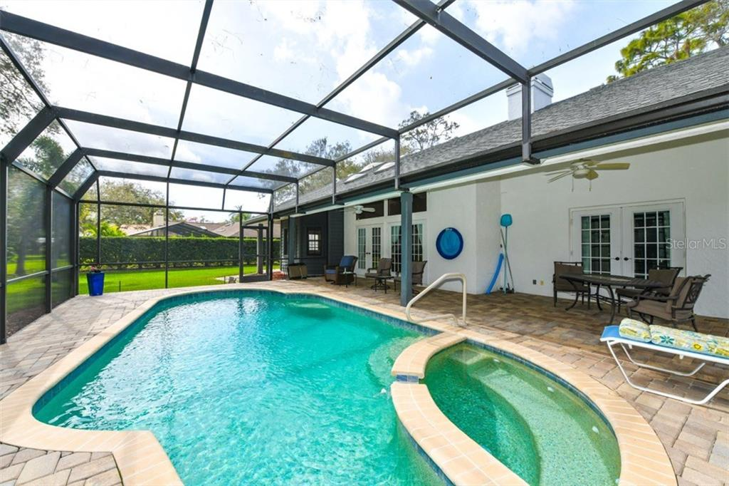Lanai across rear of home as seen from end of the pool. - Single Family Home for sale at 7536 Weeping Willow Dr, Sarasota, FL 34241 - MLS Number is A4210209