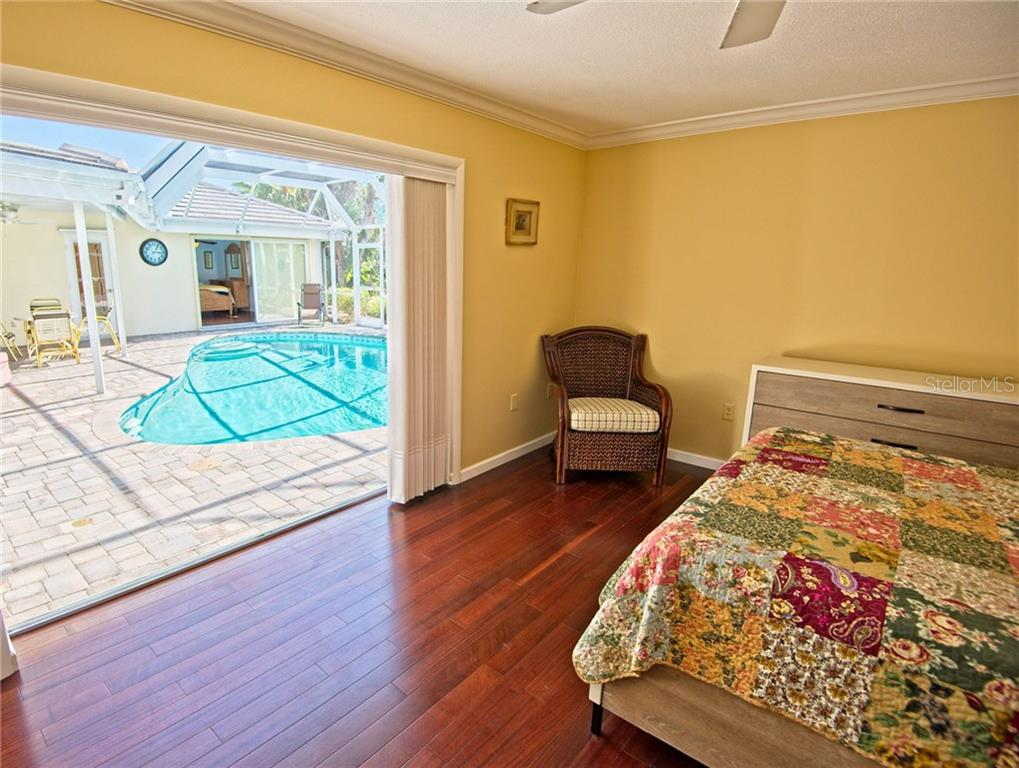 Master bedroom with pool view - Single Family Home for sale at 600 Wild Turkey Ln, Sarasota, FL 34236 - MLS Number is A4210585