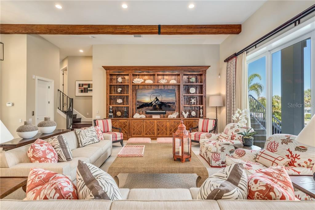 Great room with custom built Pecky Cypress entertainment center - Single Family Home for sale at 1503 Blue Heron Dr, Sarasota, FL 34239 - MLS Number is A4212851