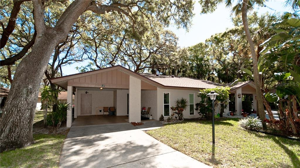 Front of villa with carport and driveway and is attached to a 2nd villa. - Condo for sale at 5107 29th St W #n/A, Bradenton, FL 34207 - MLS Number is A4213034