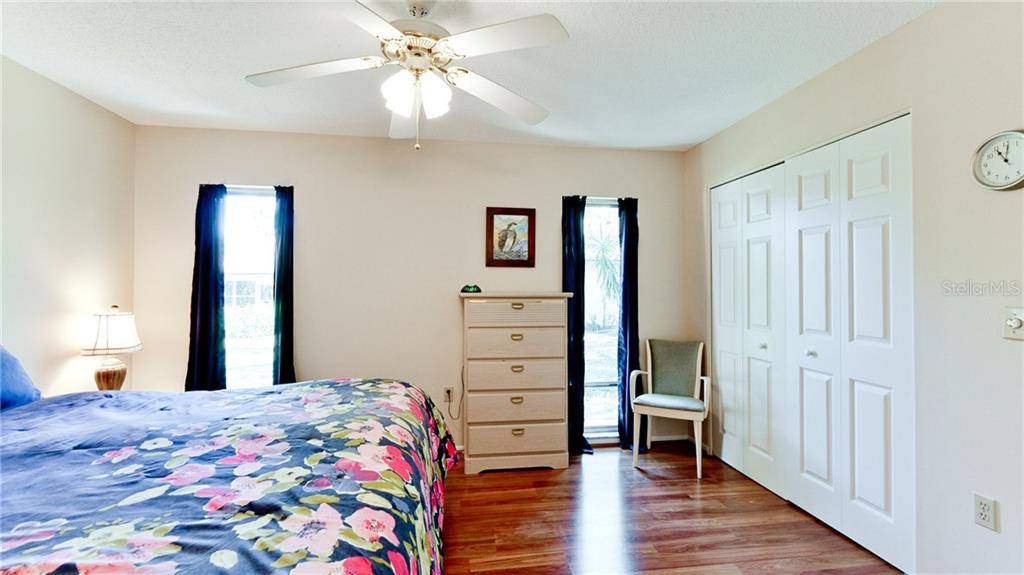 Master bedroom with in room closet and 2nd closet off the en-suite bath. - Condo for sale at 5107 29th St W #n/A, Bradenton, FL 34207 - MLS Number is A4213034