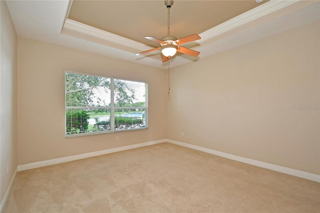 Master bedroom with tray ceiling and crown moulding.  Note the beautiful serene lake view. - Single Family Home for sale at 3729 Summerwind Cir, Bradenton, FL 34209 - MLS Number is A4215992