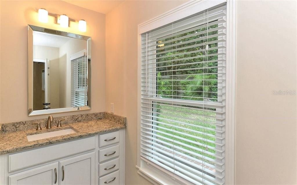 Second full bathroom easily shared by two guest bedrooms. - Single Family Home for sale at 1670 Bay View Dr, Sarasota, FL 34239 - MLS Number is A4400079