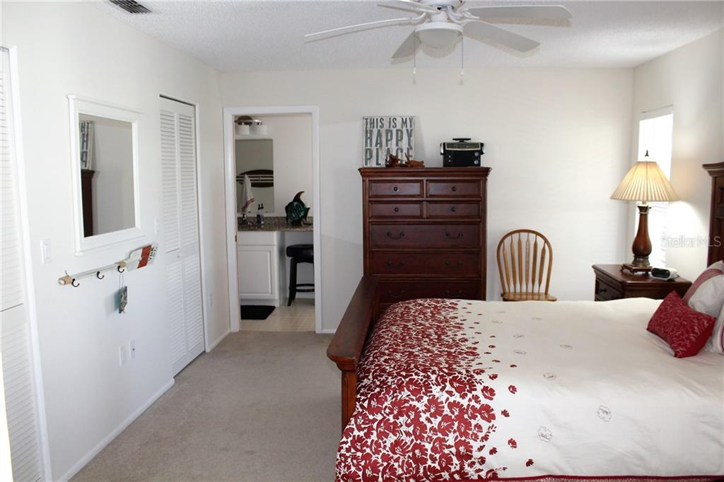 Master suite offers 2 walk-in closets and attached bathroom with granite counter top and dual sinks - Villa for sale at 5438 Kelly Dr #12, Sarasota, FL 34233 - MLS Number is A4400319