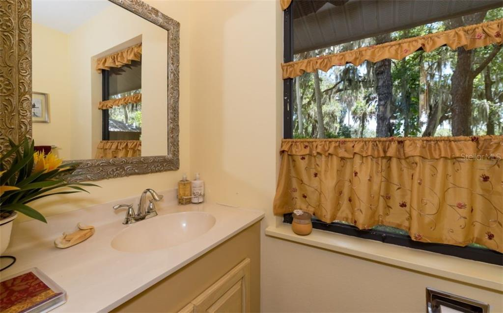 Guest House Half-Bath - Single Family Home for sale at 7865 27th St E, Sarasota, FL 34243 - MLS Number is A4400492