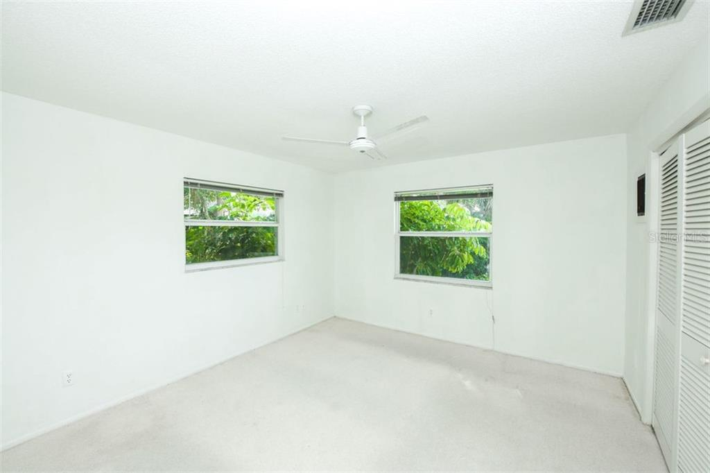 Entrance to separate guest bedroom with full bathroom.  Perfect for visitors! - Single Family Home for sale at 942 Contento St, Sarasota, FL 34242 - MLS Number is A4402415