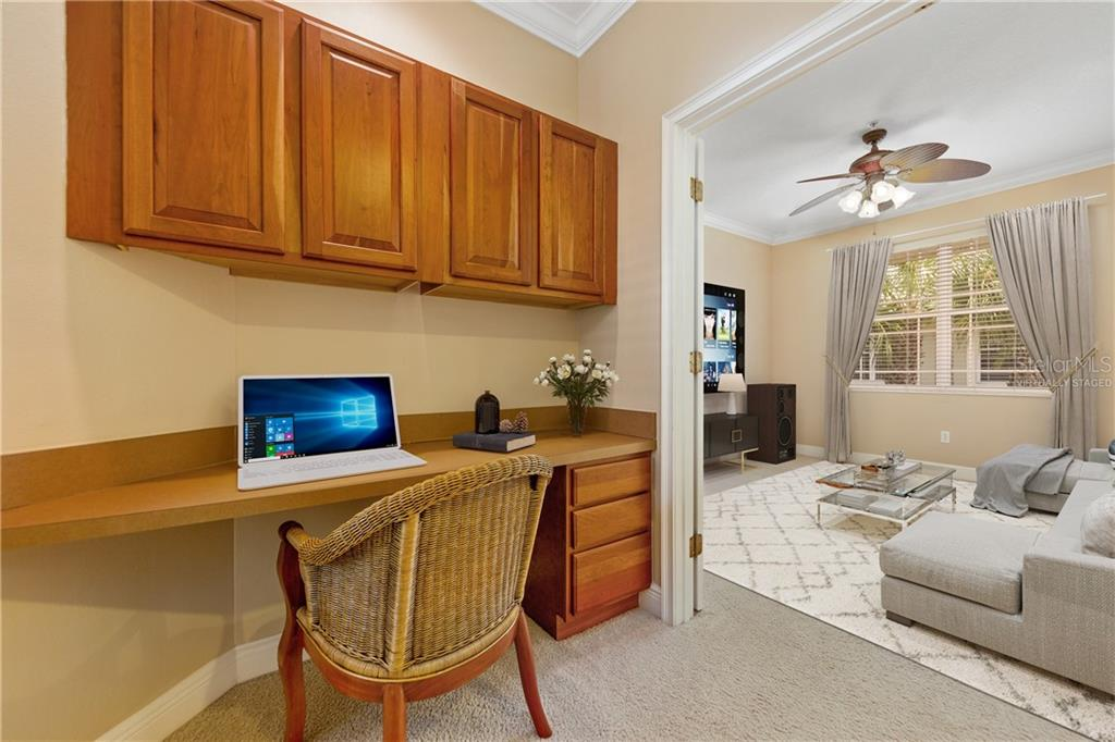 Virtually staged.  Office area with flex room set up as a tv room or media room. - Condo for sale at 6540 Moorings Point Cir #202, Lakewood Ranch, FL 34202 - MLS Number is A4403403