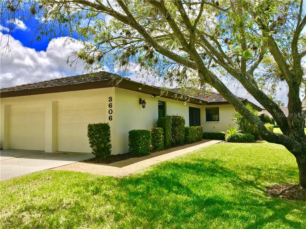 Private side entrance into this end unit Villa and oversized two car garage - Villa for sale at 3606 Gleneagle Dr #9a, Sarasota, FL 34238 - MLS Number is A4403597