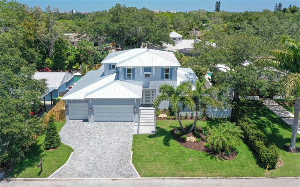 West Indies inspired design, flat tile roof, decorative shutters and a paver brick drive - Single Family Home for sale at 1905 Goldenrod St, Sarasota, FL 34239 - MLS Number is A4403697