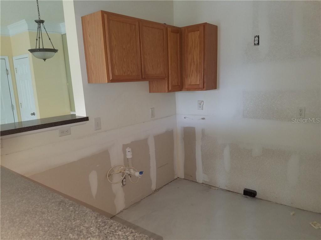 Kitchen Looking Towards Front Door - Condo for sale at 4802 51st St W #906, Bradenton, FL 34210 - MLS Number is A4403780