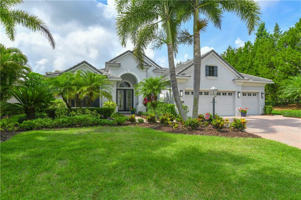 Fabulous curb appeal at the end of a private cul-de-sac with extensive landscape lighting - Single Family Home for sale at 13806 Milan Ter, Lakewood Ranch, FL 34202 - MLS Number is A4403911