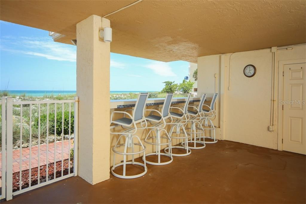 Outdoor dining area is just downstairs. - Condo for sale at 5200 Gulf Dr #101, Holmes Beach, FL 34217 - MLS Number is A4404016