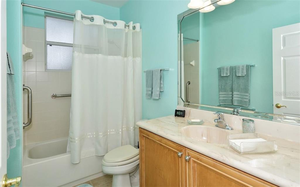 Guest Bathroom - Single Family Home for sale at 6507 42nd St E, Sarasota, FL 34243 - MLS Number is A4404611