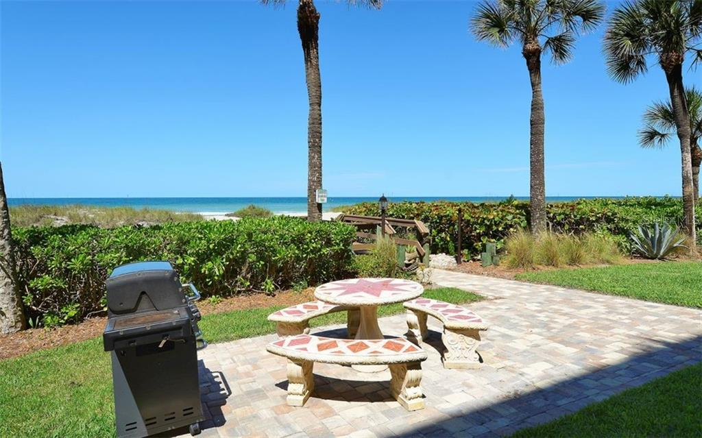 Newly pavered BBQ area with patio table - Condo for sale at 4311 Gulf Of Mexico Dr #601, Longboat Key, FL 34228 - MLS Number is A4405195