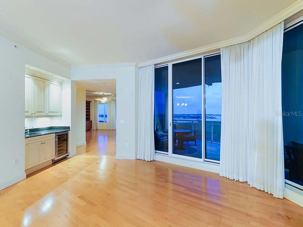 Grand Salon with Wet Bar and Wine Fridge - Condo for sale at 1300 Benjamin Franklin Dr #1008, Sarasota, FL 34236 - MLS Number is A4405360