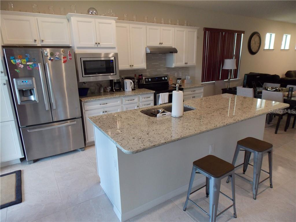 Kitchen - Single Family Home for sale at 13845 Alafaya St, Venice, FL 34293 - MLS Number is A4405755