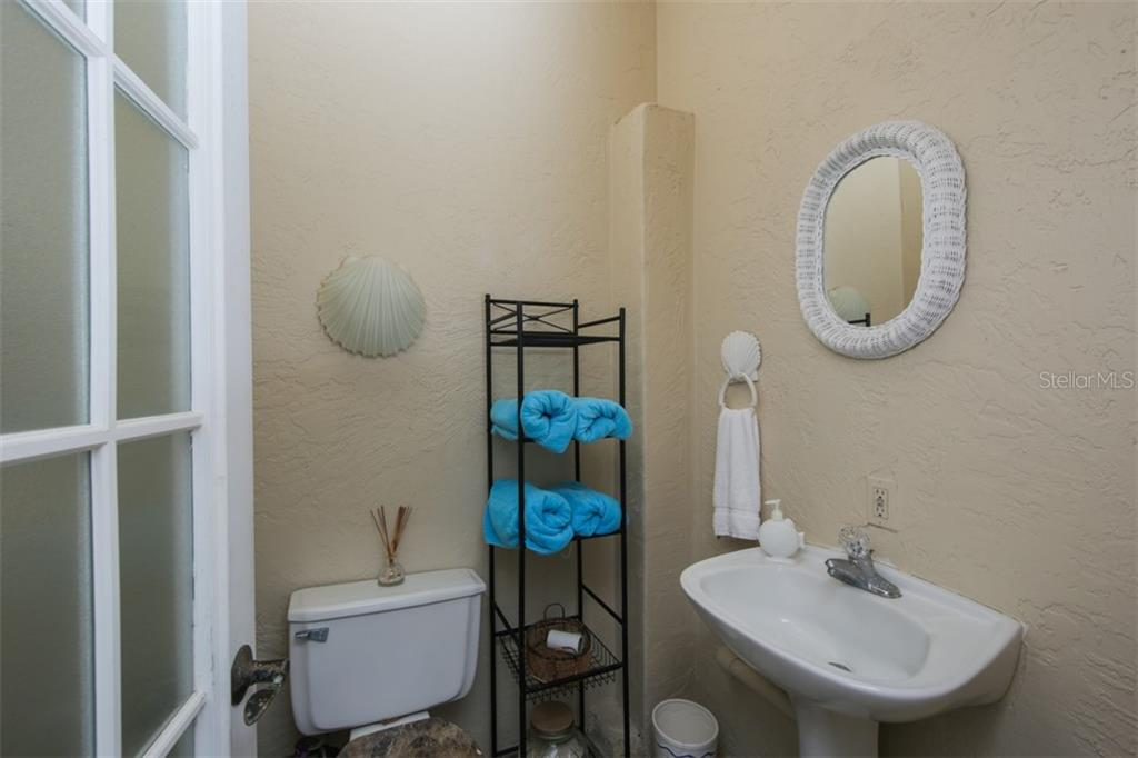 Pool half bath - Single Family Home for sale at 1778 Bayshore Dr, Englewood, FL 34223 - MLS Number is A4405962