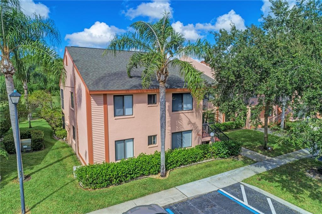 Front exterior elevation - Condo for sale at 7670 Eagle Creek Dr, Sarasota, FL 34243 - MLS Number is A4406667