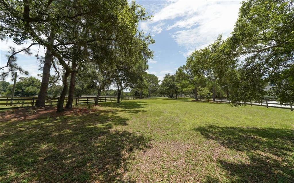 One of Three Fenced pastures that wrap around the home - Single Family Home for sale at 7866 Saddle Creek Trl, Sarasota, FL 34241 - MLS Number is A4407172