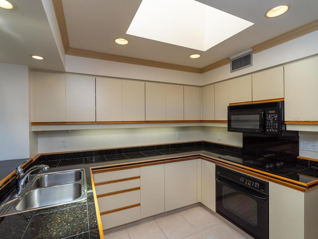 Kitchen with an abundance of natural light - Condo for sale at 1912 Harbourside Dr #604, Longboat Key, FL 34228 - MLS Number is A4407777