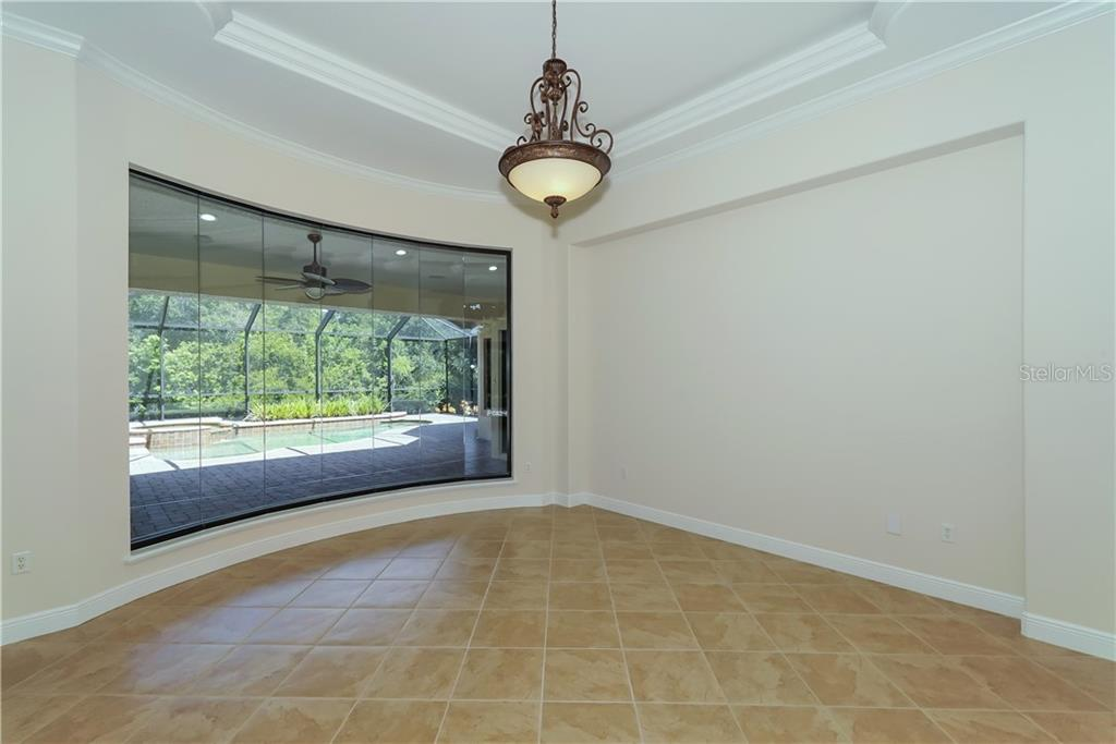 Formal Living Room features expansive floor to ceiling beveled glass window with view to lanai, pool and the preserve beyond. - Single Family Home for sale at 13219 Palmers Creek Ter, Lakewood Ranch, FL 34202 - MLS Number is A4407857