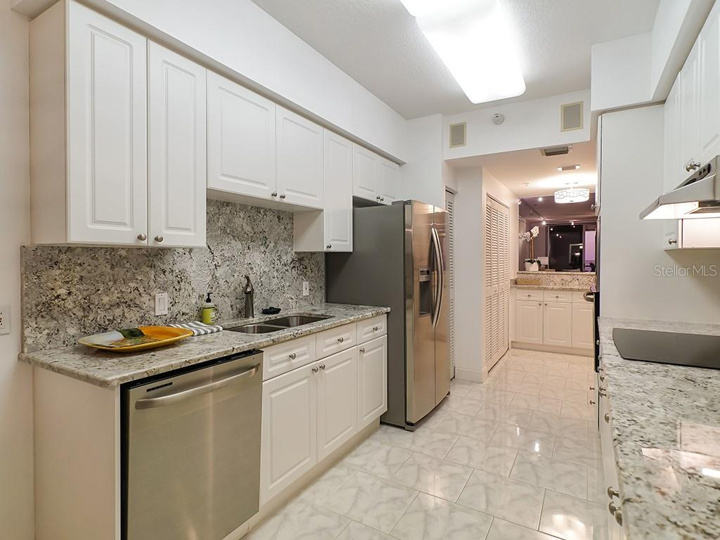 Kitchen - Stainless Steel Appliances - Condo for sale at 1800 Benjamin Franklin Dr #b409, Sarasota, FL 34236 - MLS Number is A4408201