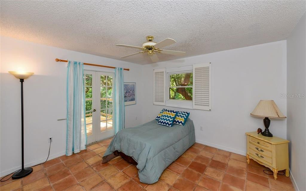 3rd Bedroom with French doors that leads to large deck in Front of House - Single Family Home for sale at 1238 Sea Plume Way, Sarasota, FL 34242 - MLS Number is A4408272
