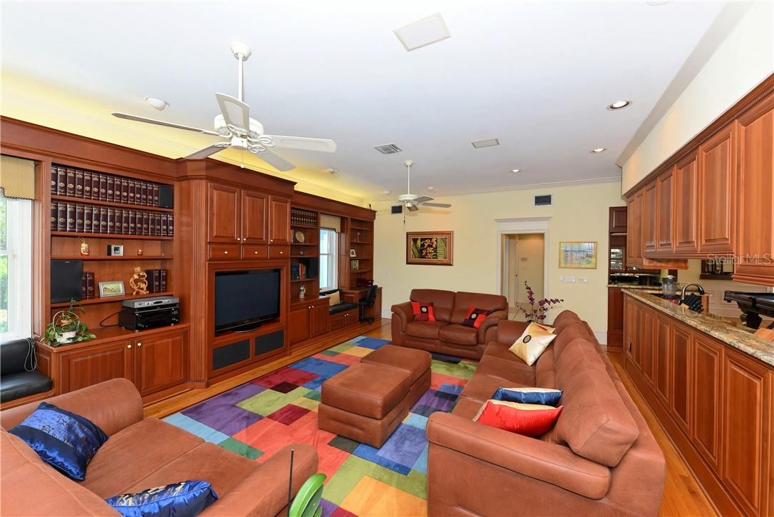 Family room has beautiful shelving for your books and collectibles. - Single Family Home for sale at 1427 Cedar Bay Ln, Sarasota, FL 34231 - MLS Number is A4408881