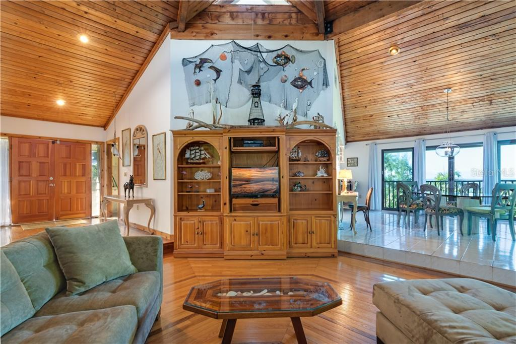 Great room, beautiful wood flooring & ceiling woodwork - Single Family Home for sale at 6661 Gulf Of Mexico Dr, Longboat Key, FL 34228 - MLS Number is A4410988