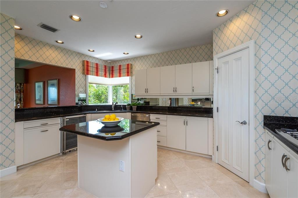 Open kitchen includes great corner window over looking the mangroves, GE monogram appliances, Marvel wine fridge, breakfast bar, walk-in pantry, recessed lighting and ample white cabinetry! - Condo for sale at 340 Gulf Of Mexico Dr #116, Longboat Key, FL 34228 - MLS Number is A4411000