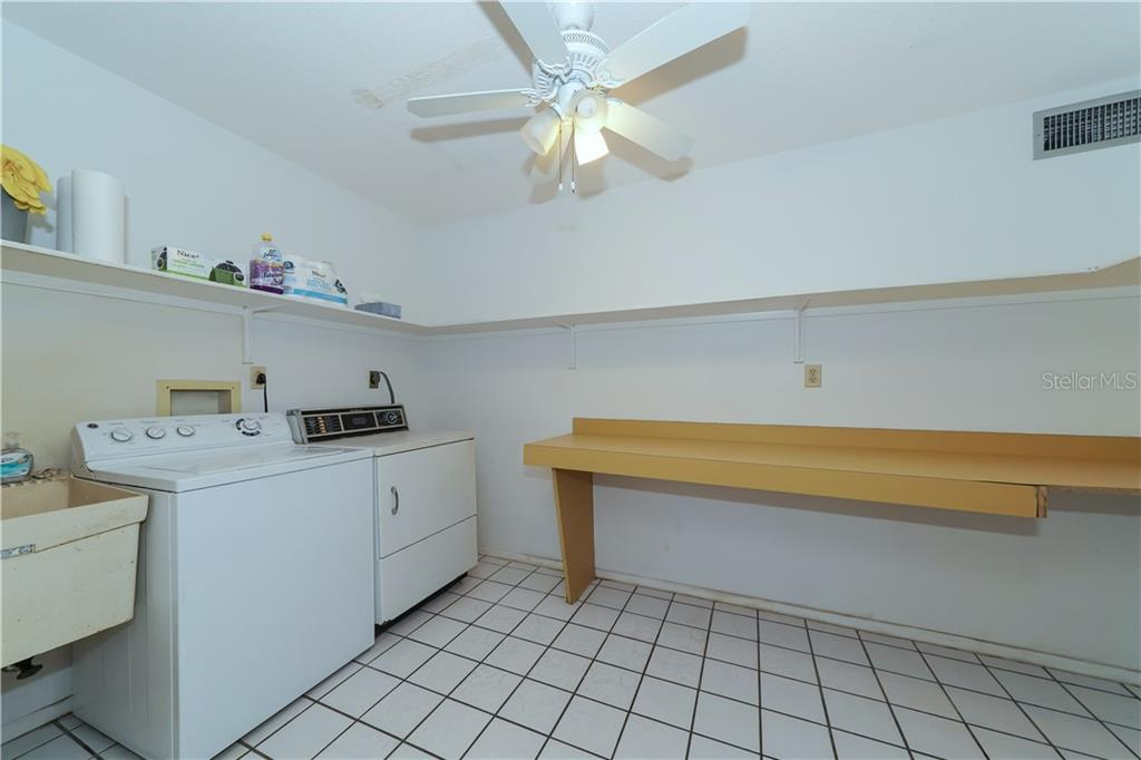 Oversized utility room - Single Family Home for sale at 5591 Cape Aqua Dr, Sarasota, FL 34242 - MLS Number is A4411099