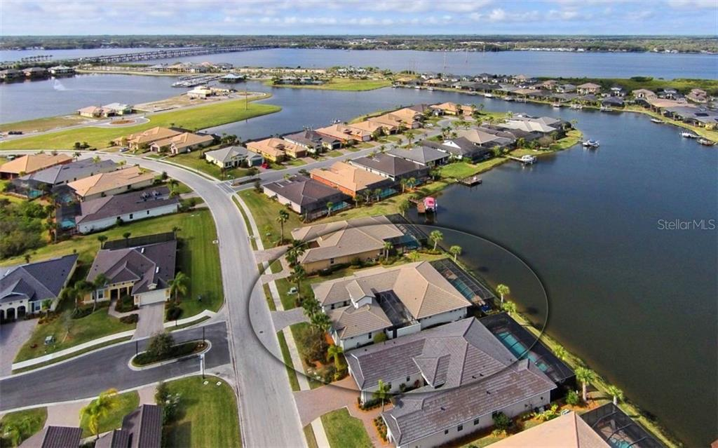 Courtyard Home situated on a lagoon with access to the Manatee River in the background. - Single Family Home for sale at 5114 Lake Overlook Ave, Bradenton, FL 34208 - MLS Number is A4412194