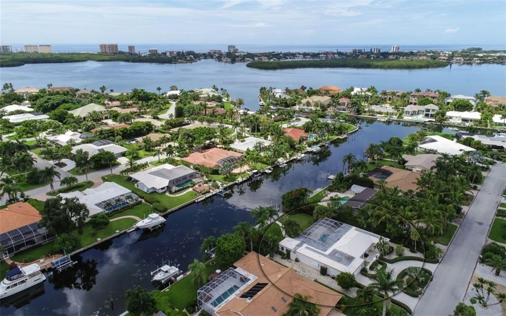 Nice wide canal. Bridge to Downtown Sarasota in the background. - Single Family Home for sale at 390 Bob White Dr, Sarasota, FL 34236 - MLS Number is A4413388