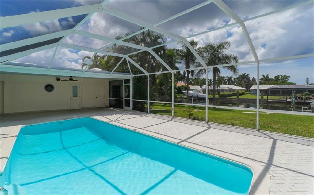 One door leads to the 4th bedroom and the other leads to the pool bath. - Single Family Home for sale at 390 Bob White Dr, Sarasota, FL 34236 - MLS Number is A4413388