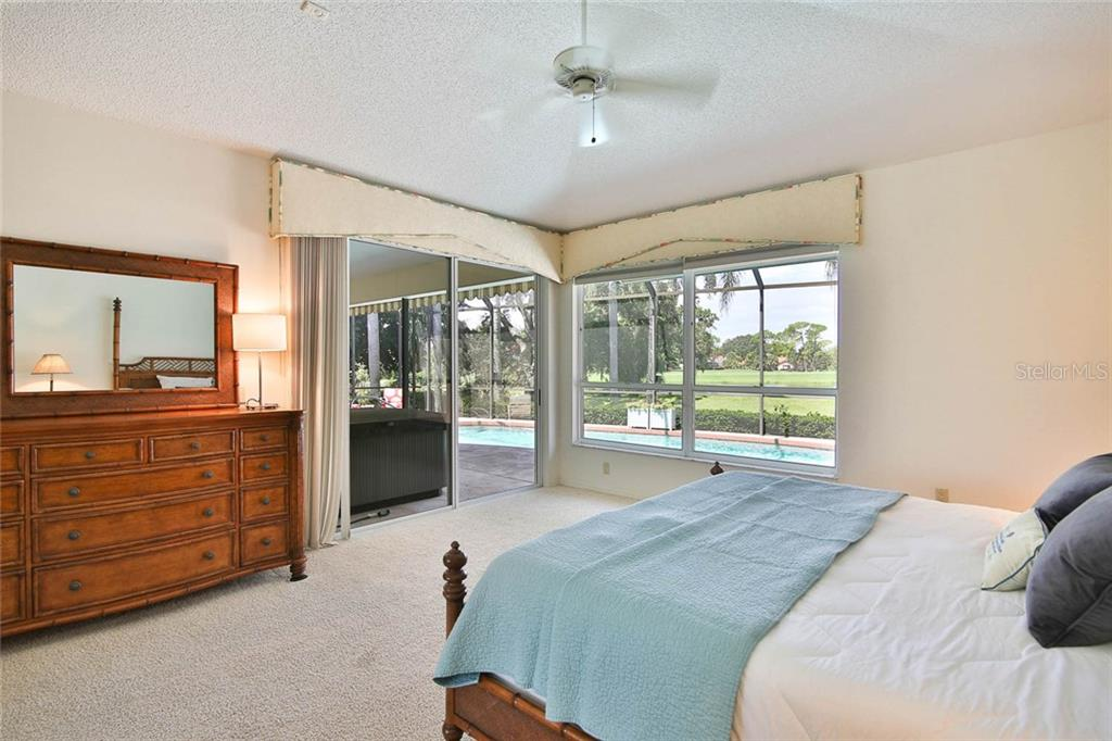 Sliders from master bedroom to the lanai. - Villa for sale at 7686 Calle Facil, Sarasota, FL 34238 - MLS Number is A4413755