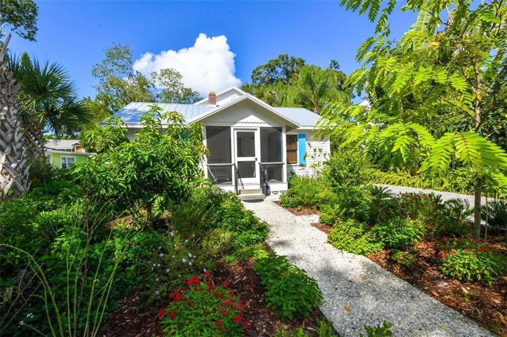Front exterior with your private driveway and beautiful shell crete walk way. - Single Family Home for sale at 550 Ohio Pl, Sarasota, FL 34236 - MLS Number is A4414310