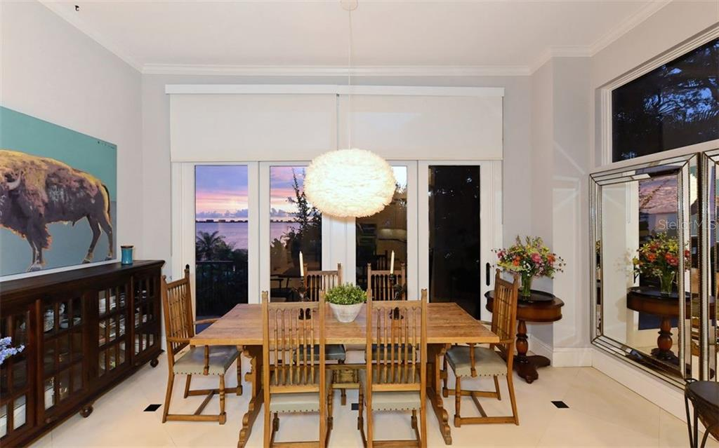 Kitchen dining area w/views of Sarasota Bay. (puff chandelier does not convey) - Single Family Home for sale at 2145 Alameda Ave, Sarasota, FL 34234 - MLS Number is A4414337