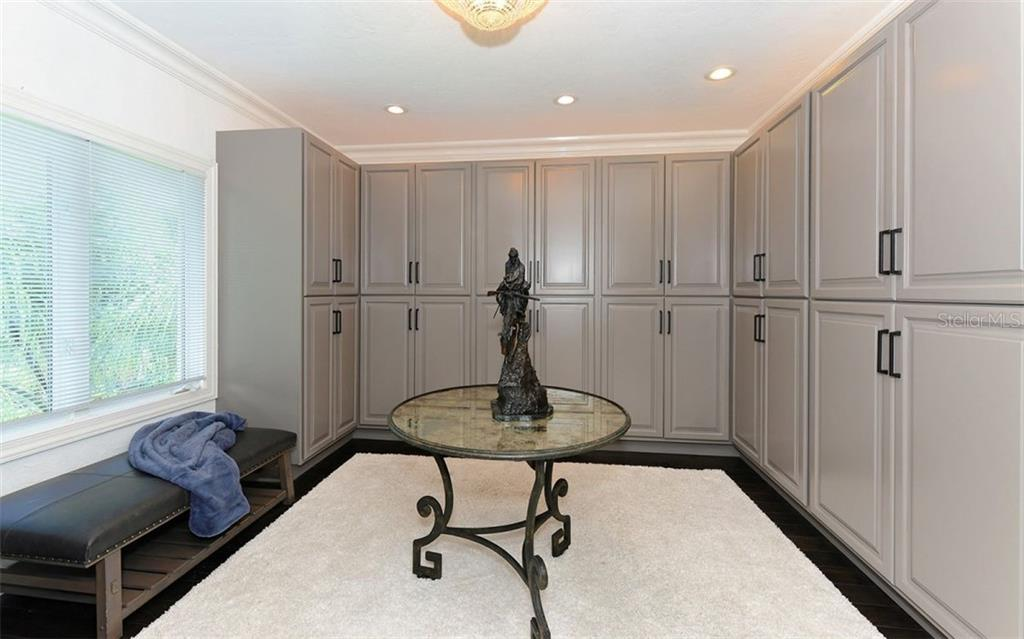 Master suite, private dressing room/walk-in closet with built-ins. (Chandelier does not convey) - Single Family Home for sale at 2145 Alameda Ave, Sarasota, FL 34234 - MLS Number is A4414337