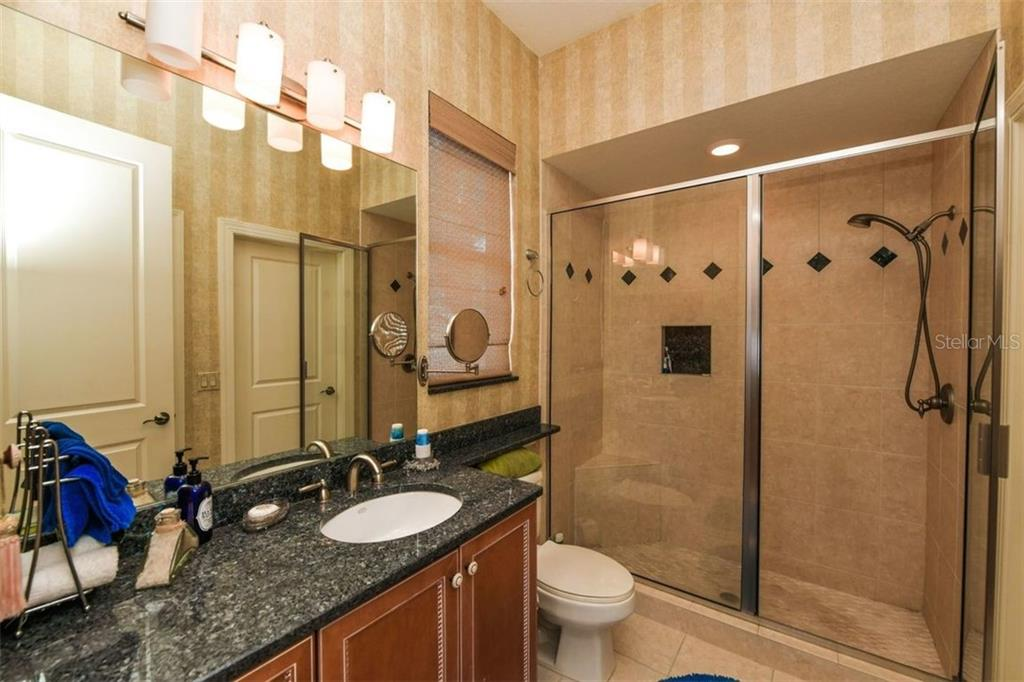Granite counters, walk-in shower. - Single Family Home for sale at 1483 Tangier Way, Sarasota, FL 34239 - MLS Number is A4414757