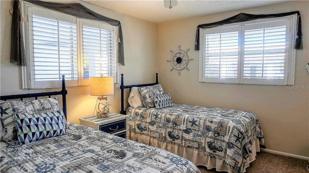 Guest room. - Villa for sale at 682 Spanish Dr S, Longboat Key, FL 34228 - MLS Number is A4414905