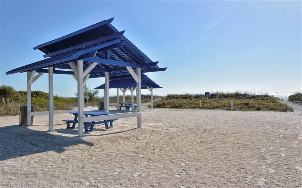 Enjoy your lunch in the shade at the private Bay Isles Beach Club - Single Family Home for sale at 3529 Fair Oaks Ln, Longboat Key, FL 34228 - MLS Number is A4414992