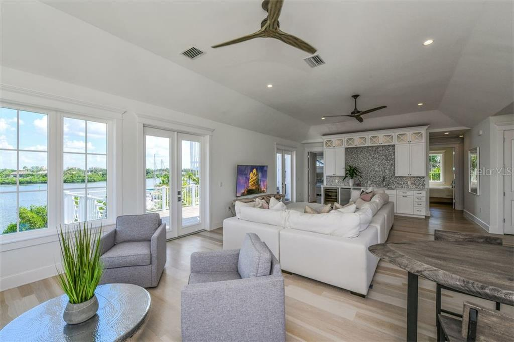 Club and entertaining room on 3rd level with spacious deck and stairs to the roof top deck. - Single Family Home for sale at 3470 Gulf Of Mexico Dr, Longboat Key, FL 34228 - MLS Number is A4415298